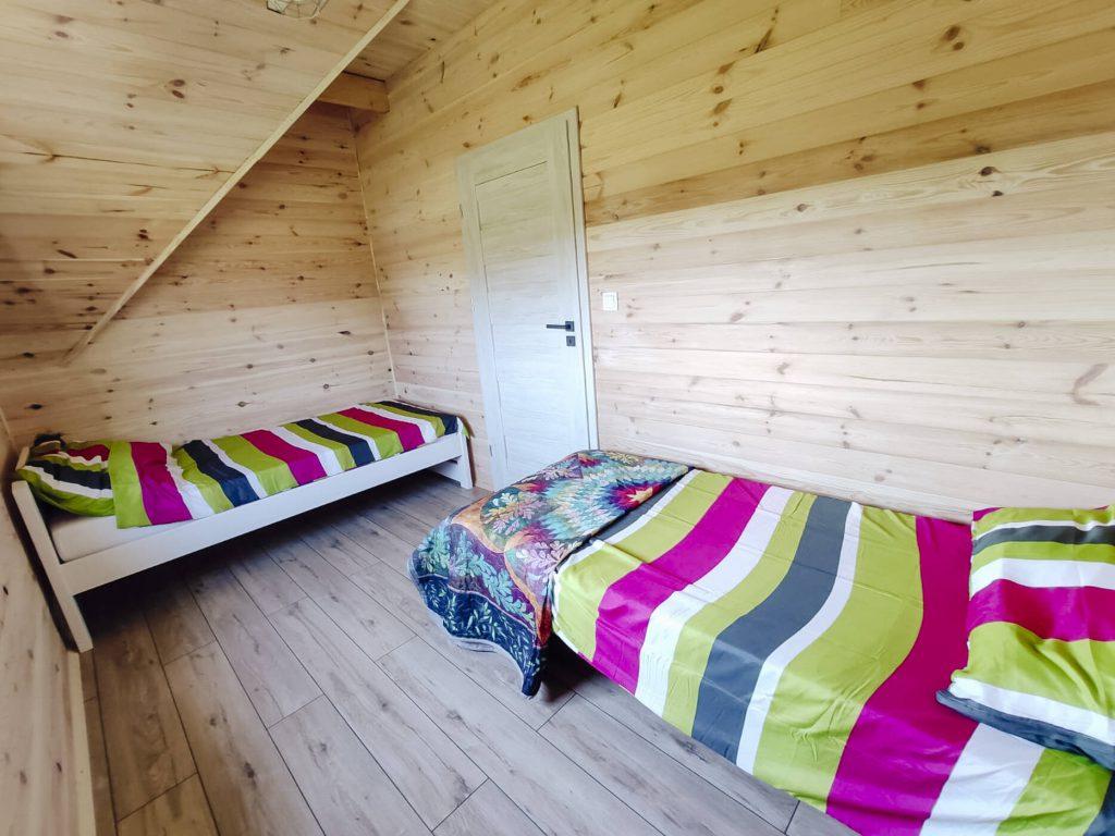 łóżka w domkach apartamentowych
